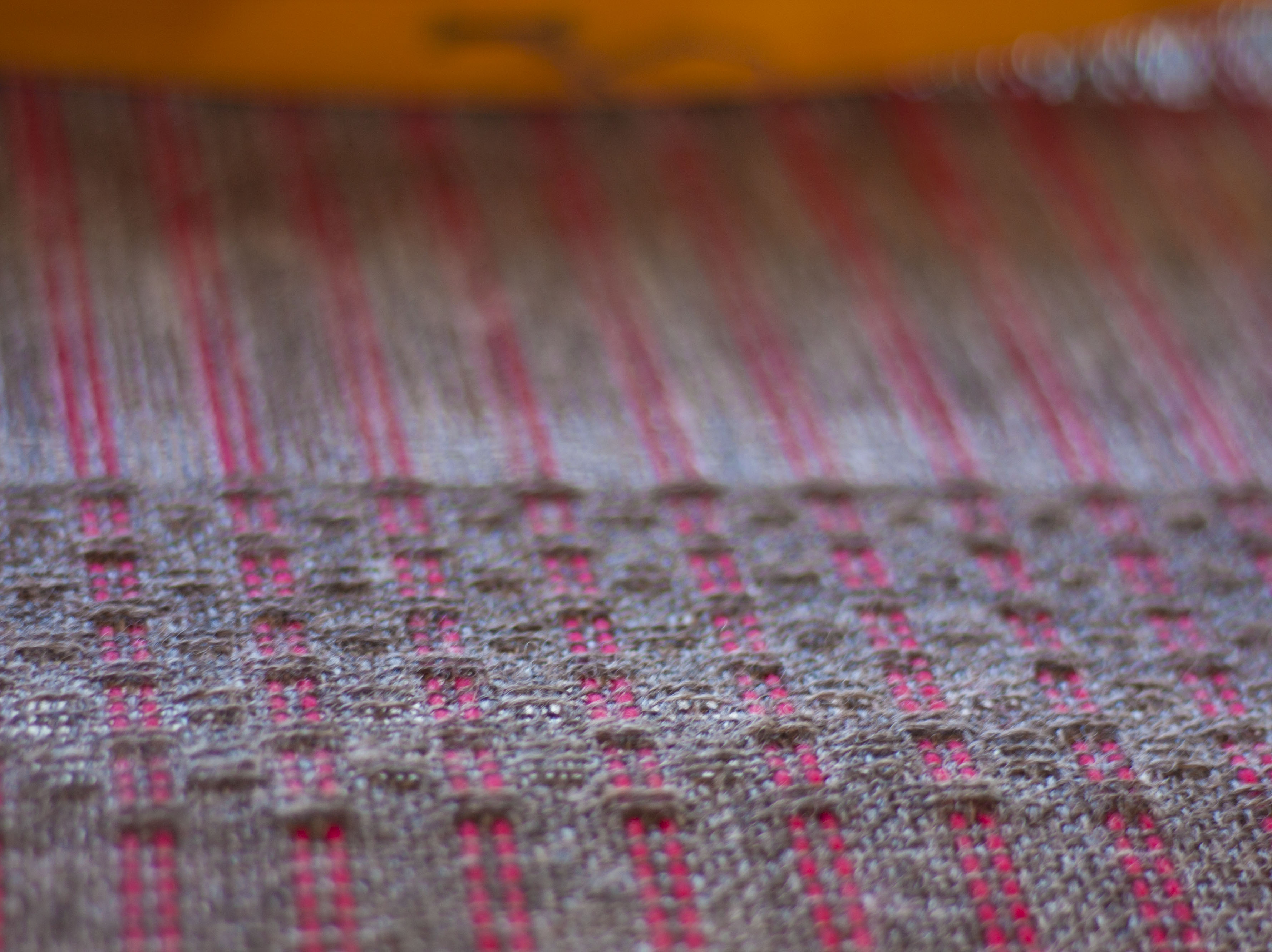 Grey red on loom